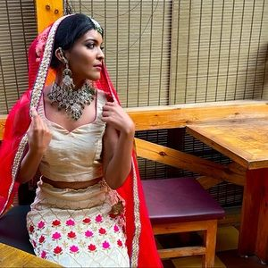 Red and gold lehenga with extra long dupatta